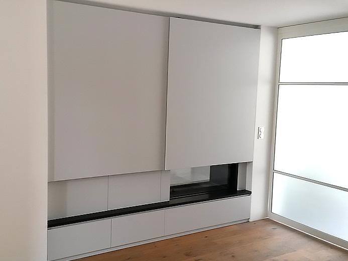 Aménagement moderne pour meuble de cheminée - Réalisation d'aménagement intérieur par Elégance Bois - Artisan Créateur à Remouillé (44) - Agenceurs sur mesure